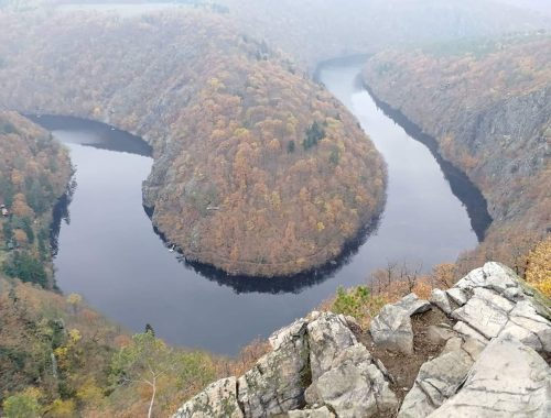 a view of a meandering river from a rock high above