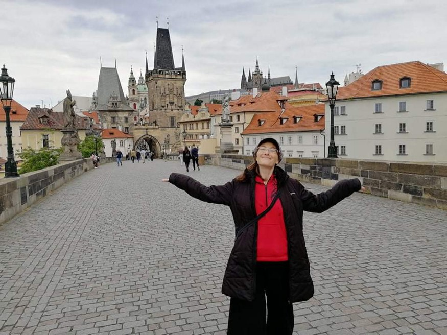 me standing at an almost empty Charles Bridge